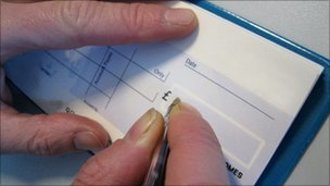 Person writing a cheque