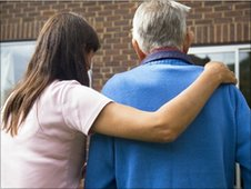 Care home worker with an elderly man