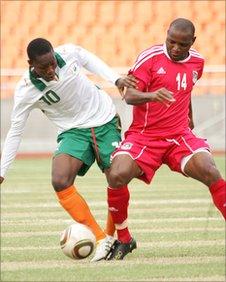 Ivorian Serge Koudio (left) and Malawi's Victor Nyirenda
