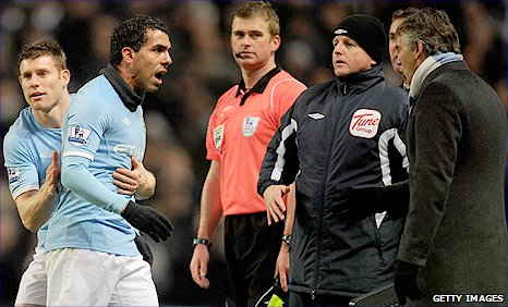 Carlos Tevez (second left) was not happy at being substituted by manager Roberto Mancini (right) against Bolton