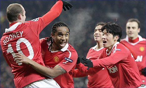 Anderson (second left) celebrates his equaliser against Valencia