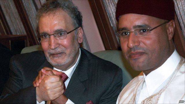Abdel Baset al-Megrahi with Saif al-Islam Muammar al-Gaddafi after his return to Libya