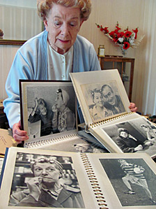 Jean Alexander looking at photos of her time in Coronation Street