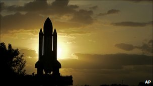Space shuttle at dawn