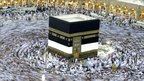 Tens of thousands of Muslim pilgrims moving around the Kaaba, the black cube seen at centre, inside the Grand Mosque in Mecca, Saudi Arabia, on Saturday