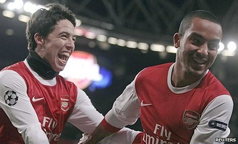 Samir Nasri (left) and Theo Walcott each scored to help Arsenal to a 3-1 win over Partizan Belgrade
