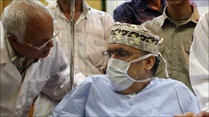 Abdelbaset Ali al-Megrahi with medical mask on