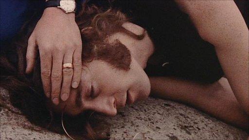 John Lennon playing dead