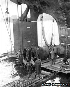 Workers removing the propeller from the 100,000 ton Tanker British Admiral