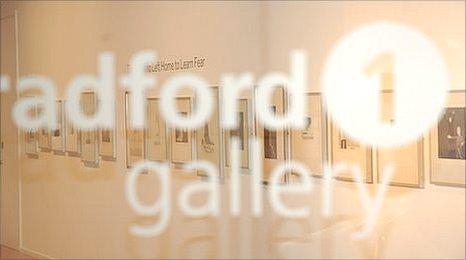 murals shown through glass door