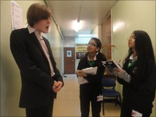 Nikita and Nishi, both 13, interview staff involved with the winter concert at Alperton Community School, London