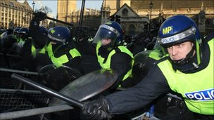 Police hold back student protesters outside the Houses of Parliament