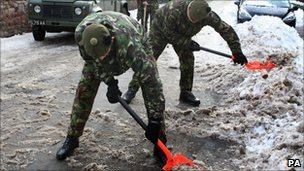 Soldiers clearing snow