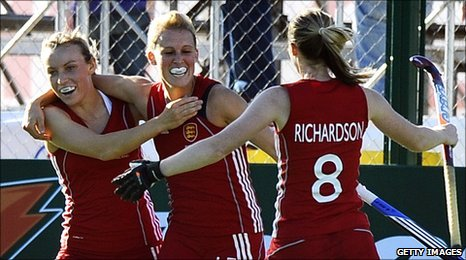 The England women's hockey team celebrate
