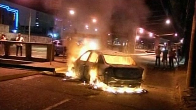 Car on fire in streets of Rio de Janeiro
