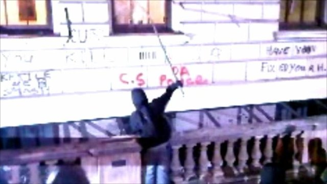 Protester attacks window