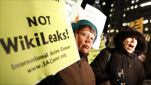 Protestors hold signs and shout in support of Wikileaks
