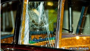 Window of royal car smashed by protesters