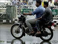 Two men riding a motor bike in Chennai
