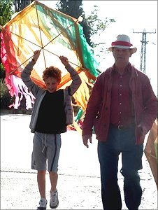Michael Morpurgo with children flying kites in Wahdat al Salaam/Neve Shalom