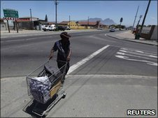A man in Gugulethu township walking near the spot where a woman on honeymoon was thought to be kidnapped