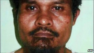 A handout photo released by Indonesian police shows top terror suspect Abu Tholut