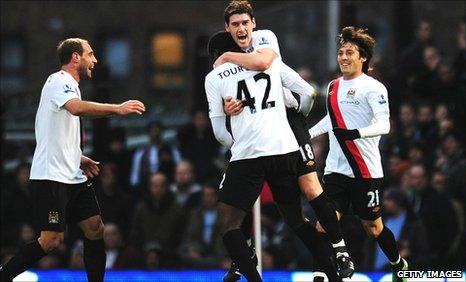 Manchester City celebrate Yaya Toure's opening goal