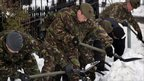 Army personnel from 1 SCOTS clear snow from roads around the Royal Hospital for sick Children, Edinburgh