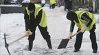 Council staff use pick axes and spades to break the ice