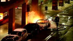 Car on fire after the first explosion