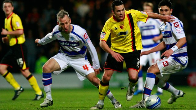 Don Cowe of Watford battles for the ball with Shaun Derry of QPR