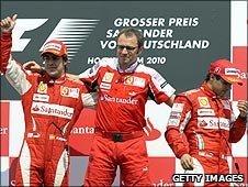 Fernando Alonso, Stefano Domenicali and Felipe Massa on the podium after the German Grand Prix