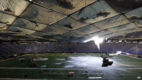 Snow falling through the damaged roof of the Minneapolis Metrodome (12 December 2010)