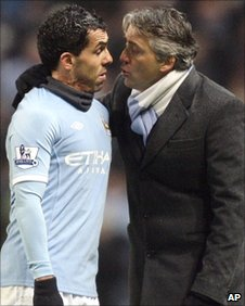 Carlos Tevez and Roberto Mancini 