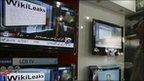 Wikileaks on TV screen, AP