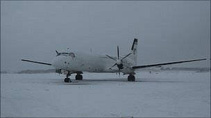 Plane covered in snow at Guernsey Airport