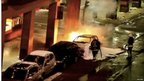 Still image taken from a video footage shows firefighters attempting to put out the fire on a car blown up in  Stockholm, 11 December 2010.