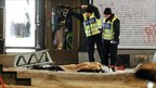 Police forensics experts examine the remains of a suspected suicide bomber in Stockholm, 11 December 2010.