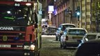 Emergency services attend the scene after a car exploded in the centre of Stockholm, 11 December 2010