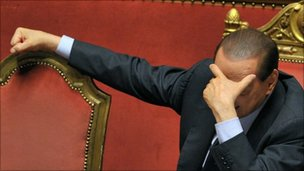 Mr Berlusconi reacts after delivering an address to the Senate on 13 December 2010 in Rome
