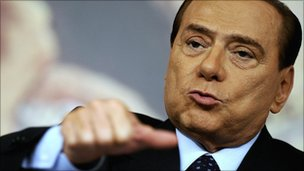 Italian Prime Minister Silvio Berlusconi gestures during a news conference in November 2010