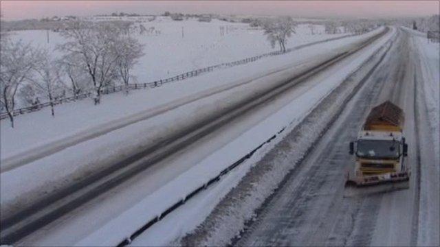Snow plough on road