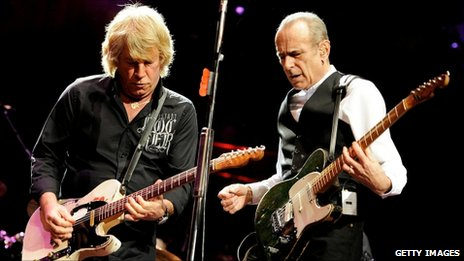 Musicians Rick Parfitt (L) and Francis Rossi of Status Quo perform at The Prince's Trust Rock Gala 2010