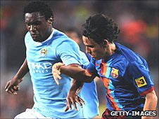 Manchester City's Kelvin Etuhu and Gai Assulin