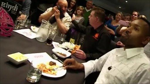 Des Coleman tasting the Vidhura the Widower curry