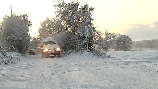 Car driving along a snowy road