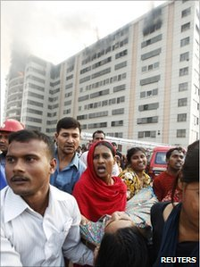 Workers and injured colleague at a clothes factory in Ashulia, Dhaka, 14/12