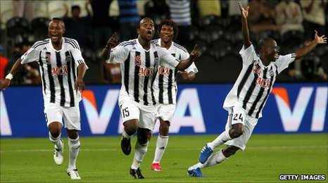 Alain Kaluyituka (No 15) and his Mazembe team mates celebrate the goal which takes the African champions to the final of the Club World Cup