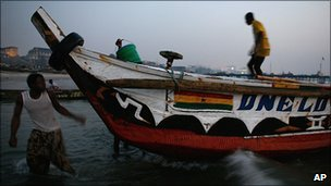 Ghanaian fishermen prepare to head out to sea just after dawn (Archive photo 2008)