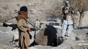 Taliban fighters man a checkpoint in Nangarhar province